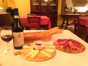 The basics in all traditional Piemontese restaurants: fresh grissini and local cheese, salumi and, of course, wine.