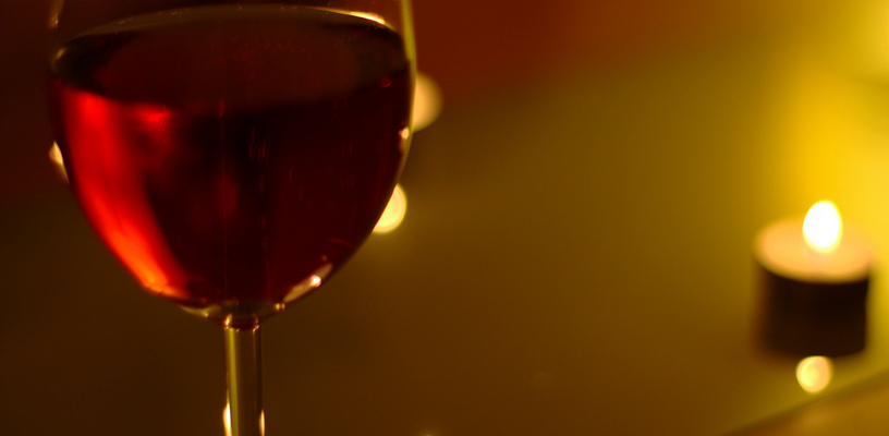 Candle & wine, Photo from andrewrennie, Creative Commons