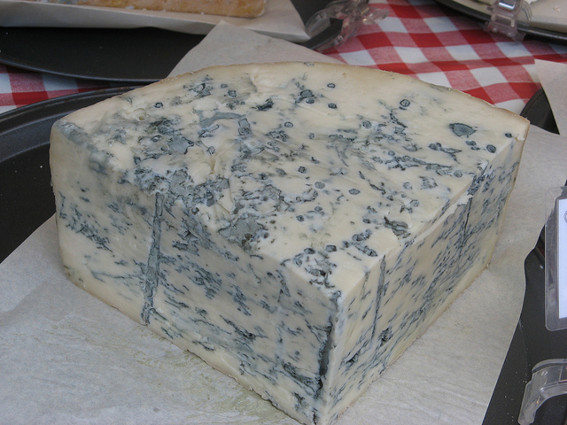 A healthy wedge of Gorgonzola cheese